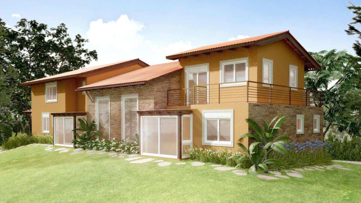 Casa com jogos de telhado, acompanhando a volumetria da construção com duas baywindows e pedra madeira filetada.