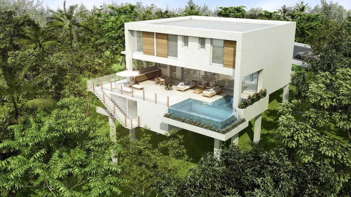 Casa construída sobre palafitas, sem tocar o solo. Toda a Mata Atlântica é preservada, com venezianas de madeira de correr e piscina com fundo infinito.