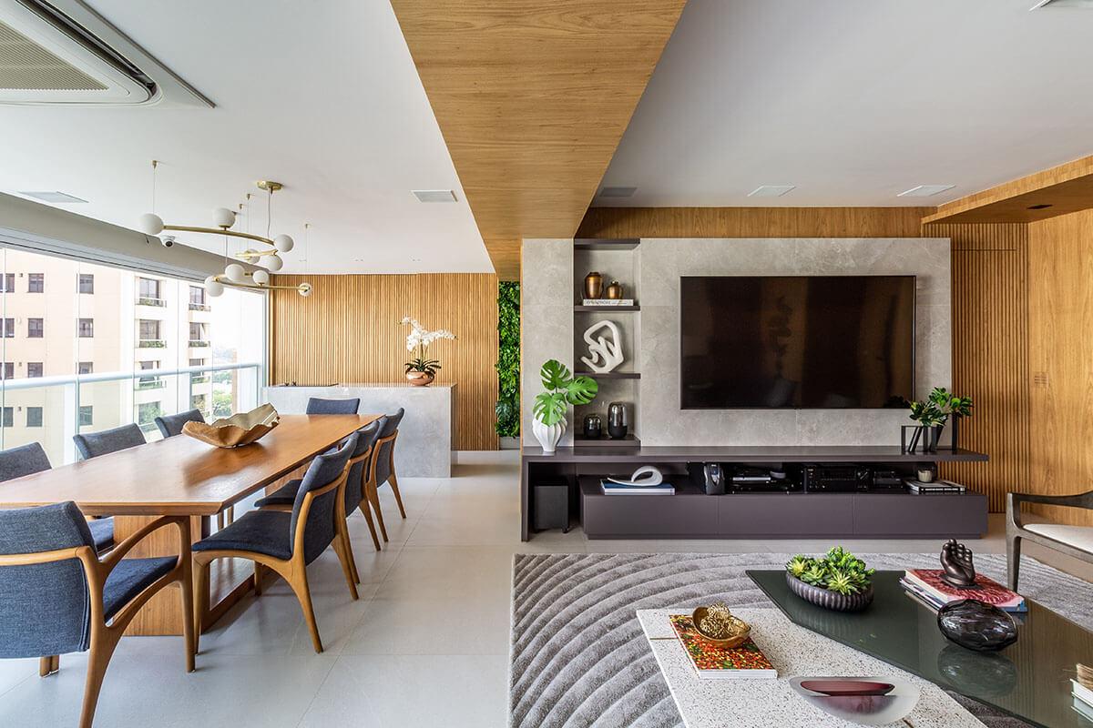 Sala integrada com varanda sala de jantar gourmet e TV